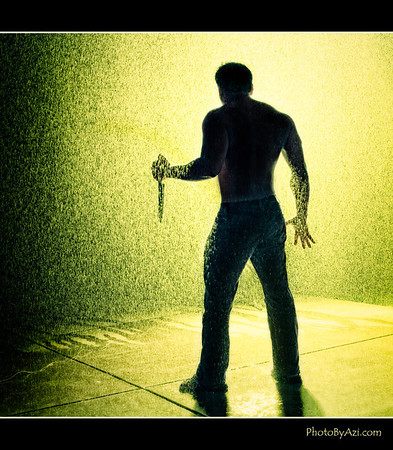 Experiementing with backlit rain (created with sprinkler) and silhouette
