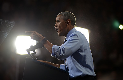 President Barack Obama addresses a crowd of 7,600 at a rally for Hillary Clinton at the Whittemore Center Arena of the University of New Hampshire in Durham on Monday, Nov. 7, 2016.