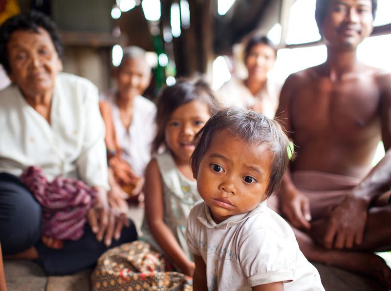 Family along river - Cambodia