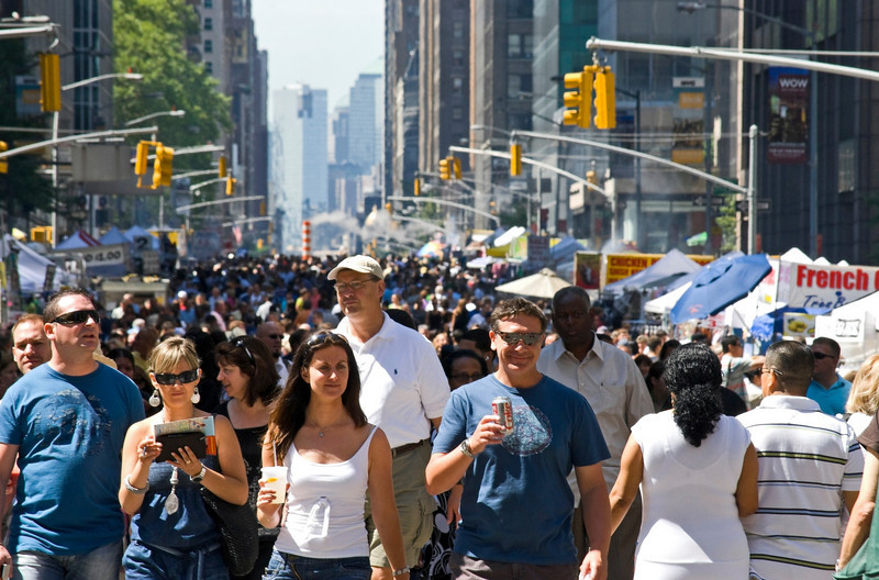 Sixth Ave. Crowd<br /> NEW YORK - JULY 30:Crowds along Sixth Ave in Manhattan for a Summer street fair on July 30,2010.