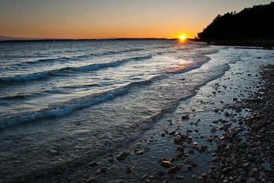 Sunset over Lake Huron from the west side of Mackinac Island in the Michigan straits