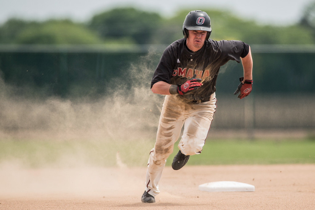 University of Nebraska-Omaha outfield Cole Gruber rounds second base in a game against Oral Roberts on May 21, 2016 in Omaha, Nebraska.