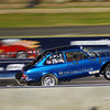 Title: Wheelie!<br /> Category: Drag Racing<br /> Location: Kwinana Motorplex, Western Australia.<br /> Notes: Taken during a drag racing even. Available light shot. Nikon D50 camera + Nikor 70-300G lens (not the VR version which I purchased later) + Tripod to assist with the panning.
