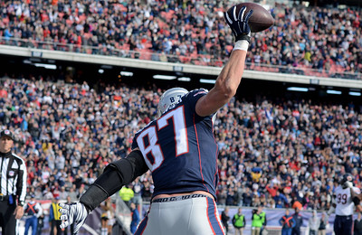 New England's Rob Gronkowski cocks his arm back to spike the ball in celebration after making a touchdown catch with 1:55 to go in the first half of the home game against the Chicago Bears on October 26, 2014.