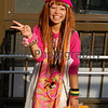 "Title: ""Hippy Girl""<br /> Category: Street Portrait<br /> Location: Shinsaibashi, Osaka, Japan<br /> Notes: Ritsuko and I were walking through Shinsaibashi with our friend Pastor Jeff MacKay and suddenly he called over this girl and asked her to pose for me. I'm not sure if he knew her or it was just random. One interesting thing I noticed about a year and a half later when I was showing this photo the buyer of this camera and lens as an example, was one of her bands had ""W.W.J.D."" on it. This made me suspect that she was someone Jeff knew, but I still haven't asked Jeff about this. Then I read somewhere that Japanese noticed many American Sports Stars wearing ""W.W.J.D."" bands that these have been copied and now sell in sport shops here (I've not seen any for sale personally). Taken with a Nikon D50 camera + kit Nikkor 18-55 (non VR, version 1) lens."