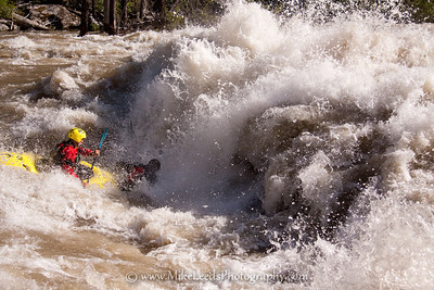 "Micah Kneidl and Tyler Allyn going big in class IV ""Slalom"" rapid on the Lower S.F. Payette River around 10,000cfs. They are paddling a two person hardshell kayak. Tyler got sucked clean out of the boat leaving his spray deck still attached to the boat, forcing Micah to swim. Good times around Banks Idaho!"