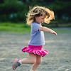 Little Girl Spinning Around And Dancing