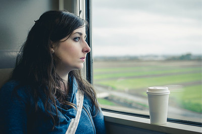 Woman On Train With Coffee