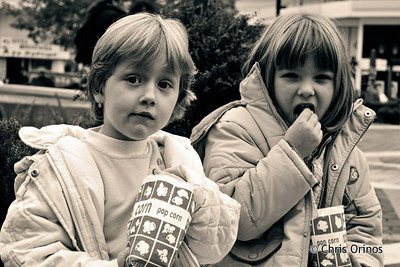 Two kids enjoying their pop-corn in Kalabaka, Greece.
