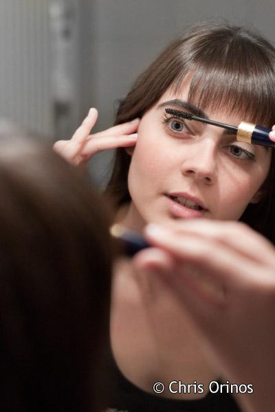 Ifigeneia taking care of her eyelashes.