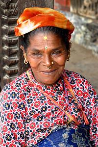 Lady sitting in Durbar Square, Kathmandu, Nepal