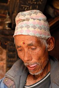 This Nepali man was busy doing his own thing. Image taken in Pathan Durbar Square, Kathmandu, Nepal.