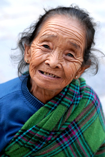 Sweet old lady in Kathmandu, Nepal. She was short and had a small structure. She saw me taking pictures and without me knowing, just came up to me and gave me this big grin which I captured.
