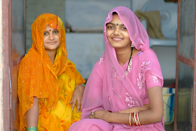 Sister and Sister-in-law sitting at the entrance of their home in Jodhpur, Rajasthan, India.