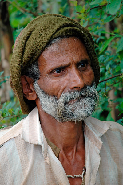 Gardner [India]<br /> Took this candid shot of a gardner when on the trip to Goa, India. He had this intense gaze - almost scary if seen in the dark coming out of the bushes.<br /> While he took care of the garden, he was also handling the silk farm.