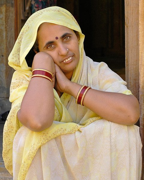Lady sitting at the entrance of her house in Jaisalmer Fort, Jaisalmerr, Rajasthan, RJ, India.