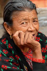 Nepali lady sitting in Pathan Durbar Square. Kathmandu, Nepal.