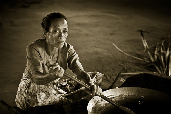 Woman stiring jaggery (palm sugar candy)