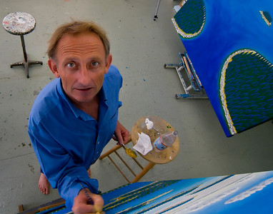 Famous Rockland, Maine artist, Eric Hopkins, painting in his studio.