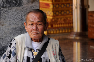 A man in repose at a temple in Chiang Mai, Thailand.