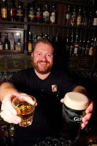 Bull Feeney's bartender, Jeff Grundy proffering one of his signature drinks.