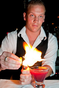 Vignola's Scott Doherty, bartender supreme, lighting the essential oil from an orange peel to subtly flavor one of his signature drinks.  Delicious but dangerous!