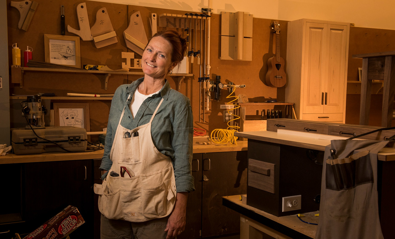 A wood technology student poses during class in the lab at The Wood Technology Center of Seattle Central College.