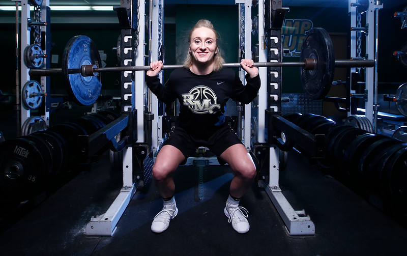 Marissa Van Atta squats in the weight room at Rocky Mountain College in Billings, Mont. on Dec. 6, 2018. After being diagnosed with leukemia in September of 2017, Van Atta has returned to the basketball court for the Battlin' Bears.