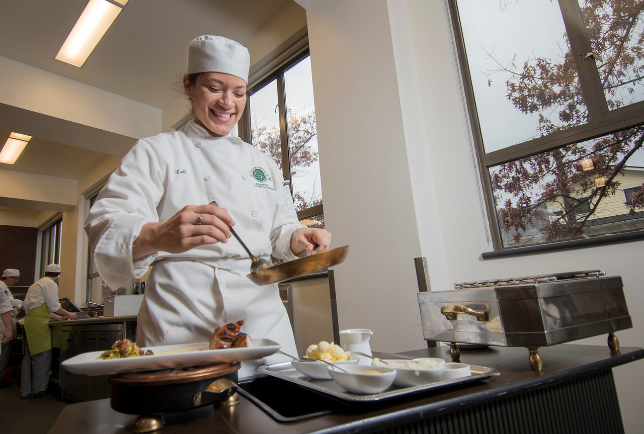 A culinary arts student works in the kitchen of the One World Restaurant at Seattle Central College on January 27, 2016.