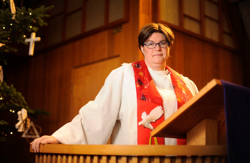 Reverend Laura Beville stands at the pulpit of the Harmony United Methodist Church where she has been assigned for the past 20 years in Coos Bay, Ore. on Dec. 21, 2017. Rev. Beville shared her experiences with sexual assault within the ranks of the Methodist organization to show solidarity and support to the recent #Metoo movement.
