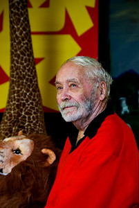 Robert Indiana and two of his stuffed animal collection, a lion that roars and a very tall giraffe. Robert Indiana, iconic 1960s artist