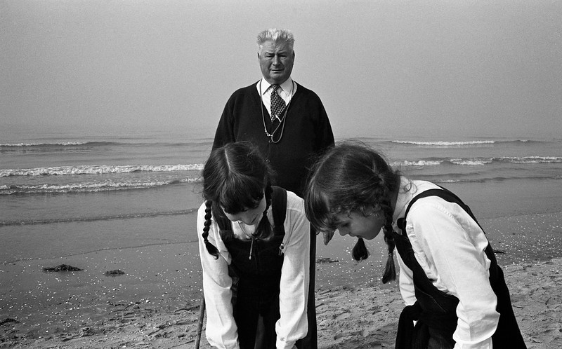 Twin girls and grandfather, North Sea, Belgium, circa 1980 © Copyrights Michel Botman Photography