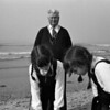 Twin girls and grandfather, North Sea, Belgium, circa 1980 © Copyrights Michel Botman Photography