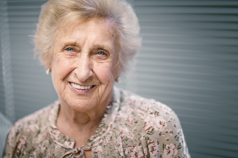 An older woman smiling and surprised.