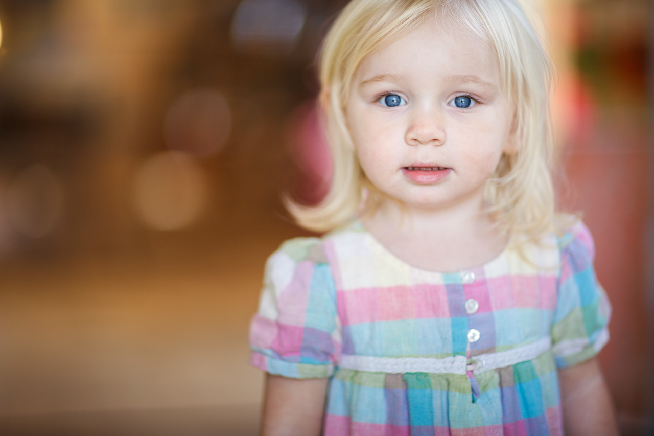 An inquisitive young girl standing.