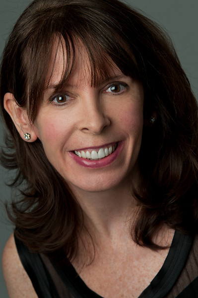 "Headshot of a woman with brown hair and brown eyes wearing a black top smiling for the camera Alex Kaplan Photographer <a href=""https://professionalheadshots.com"">https://professionalheadshots.com</a>"