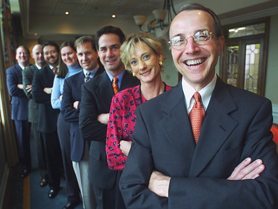 Ross & Yerger president Eason Leake (foreground) is among a group of company employees who are all smiles since they purchased the Jackson-based insurance firm earlier this month.