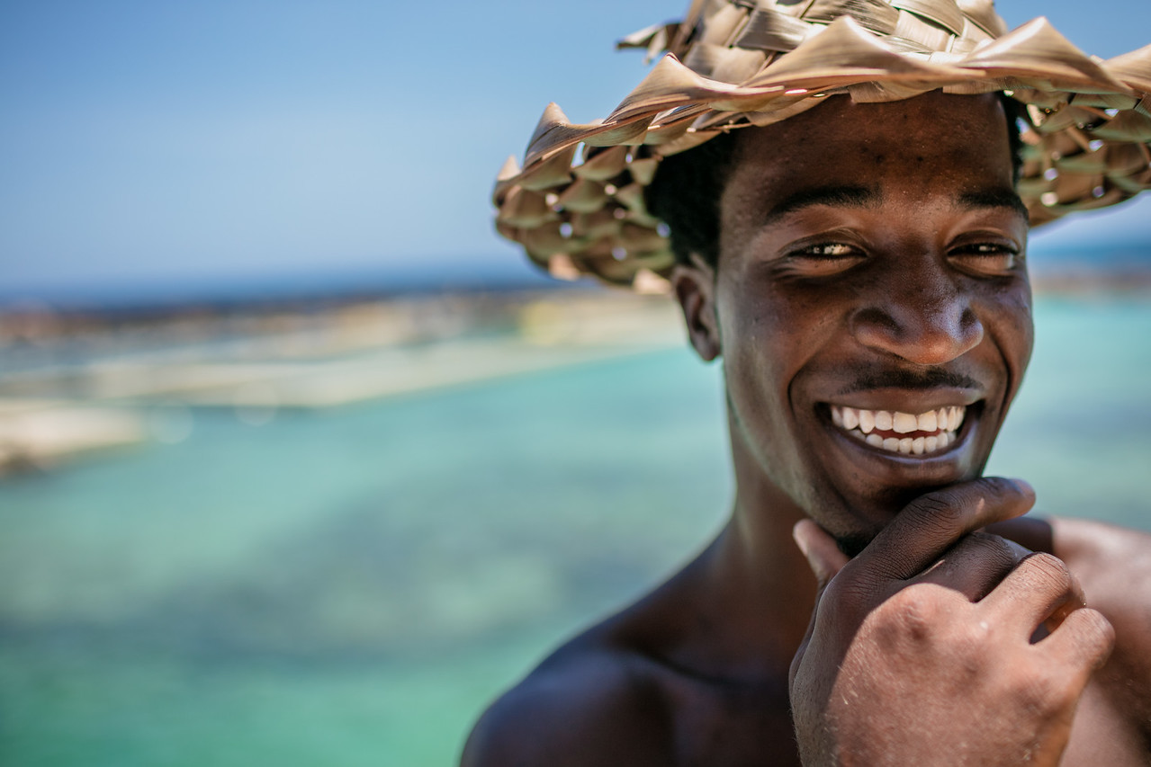 Portrait of an African Jamaican man smiling on the beach.
