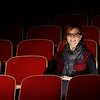 Stacy Hurt sits in the audience seats at the Princeton Community Intermediate School auditorium. Hurt has worked with the Gibson County Youth Theater Group for years.