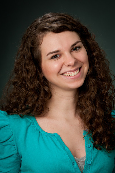Girl with brown hair and brown eyes wearing a blue shirt smiling for the camera Girl with brown curly hair wearing a snakeskin jacket and a teal shirt looking confused at the camera and holding her hands up in the air Alex Kaplan Photographer https://professionalheadshots.com