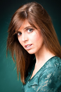 Portrait of a woman with brown hair and blue eyes wearing a blue patterned shirt modeling for the camera by Alex Kaplan, photographer http://www.alexkaplanphoto.com