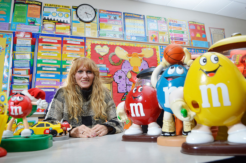Mary Coomer, a fourth grade teacher at Princeton Community Intermediate School, with some of the M&Ms figures that decorate her classroom.