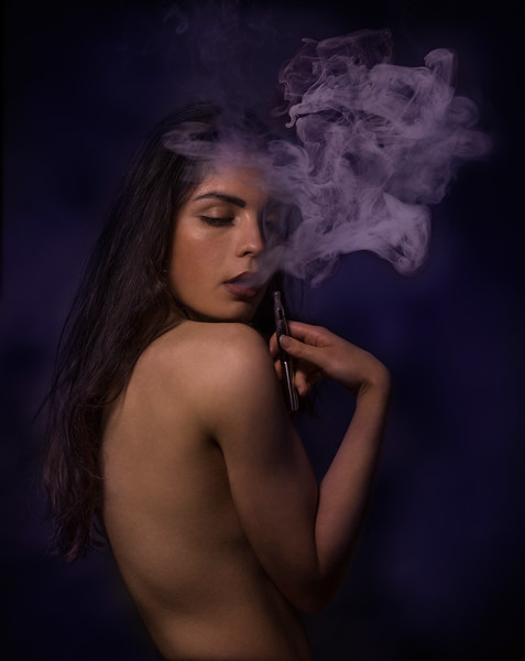 Sensual young woman vaping