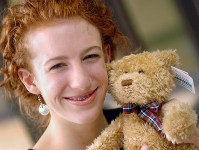 Claire Carwford, 14, of Starkville, delivered more than 300 bears from the Cleft Palate Foundation to the Blaire E. Baton Hospital for Children at the University of Mississippi Medical Center in Jackson on Friday that will be given to children under treatment in the hospital's pediatric craniofacial center which treats cleft lip and palate. Crawford, who was born with was born with a cleft lip and palate, raised money for the bears as part of her Girl Scout Silver Award project. The Cleft Palate Foundation uses proceeds from the sale of the bears to fund research. The bears, made by Gund, have stitches on their upper lips like a patient would following surgery.