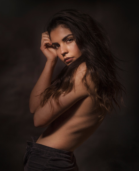 Portrait of topless young woman