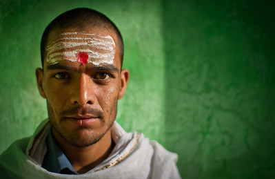A temple worker poses for a portrait, Varanasi, India, March 2012.