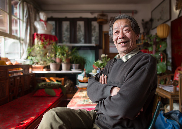Mr. Liu, Grand Champion Cricket Fighter, poses for a portrait in his home in Beijing, China, 2012