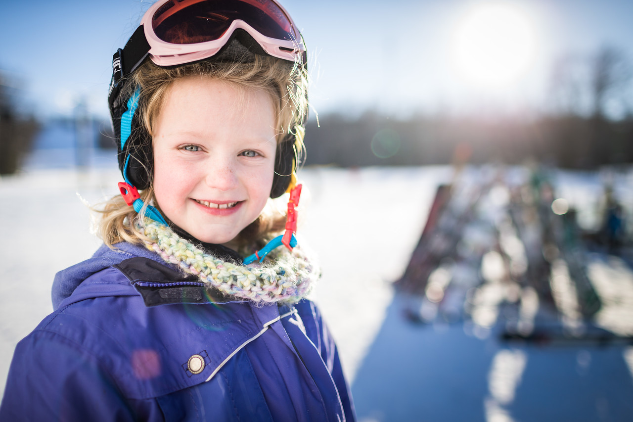Portrait of a young girl on a ski hill.