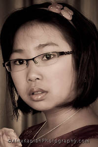 Young girl wearing glasses with short hair looking at the camera Alex Kaplan Photographer https://professionalheadshots.com