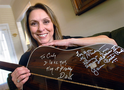 "Among Cindy Cash's prized possessions is a Martin acoustic guitar autographed by her father, legendary singer and songwriter Johnny Cash, and his second wife June Carter Cash. The messages read ""To Cindy I love you, play it pretty Dad"" and ""For you My Cindy -- always your loving Mother II June Carter Cash""."
